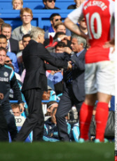 Managers Arsene Wenger of Arsenal and Jose Mourinho manager of Chelsea clash