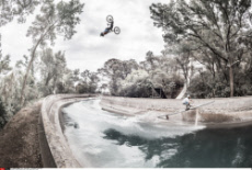French Mountain Bike rider jumps over a canal