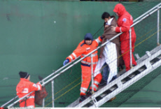 Bari People rescued from the fire stricken of Norman Atlantic ship arrived at harbour of Bari Italy