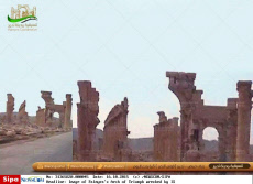 Image of Palmyra's Arch of Triumph wrecked by IS
