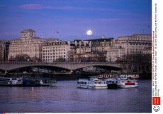 Moon Setting over the River Thames, London, Britain - 25 Jan 2016