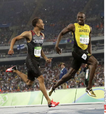 Andre De Grasse, left, and Jamaica's Usain Bolt during a men's 200-meter semifinal