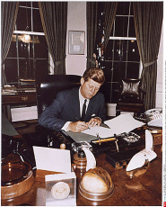 United States President John F. Kennedy signs Cuba Quarantine Proclamation at his desk in the Oval Office of the White House in Washington, DC on October 23, 1962. Mandatory Credit: Robert Knudsen/White House via CNP Photo via Newscom