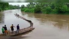 Bamboo Bridge Washes Away