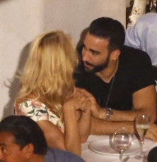 Exclusif , Pamela Anderson and Adil Rami date. **STRICLY NO WEB**