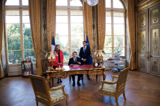 PARIS: Emmanuel Macron sign documents to promulgate the bills for faith in French political life .