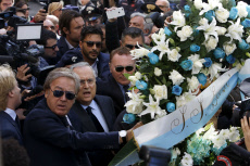 Claudio Lotito lays flowers at the synagogue in Rome Italy