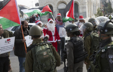 Protestors Dressed As Santas