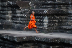 Young Buddhist monk at Angkor Wat Temple in Siem Reap, C...