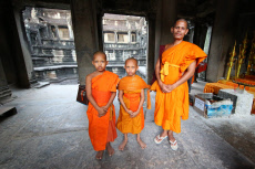 Young Buddhist monks at Angkor Wat Temple in Siem Reap, ...