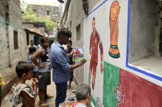 India: Artist paints a footballer in wall