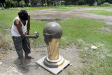 India: Artist paints clay model of World Cup trophy