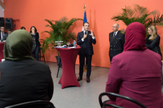 Lens: Macron attends a meeting with local association
