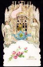 Two angels with nativity scene on a Christmas card