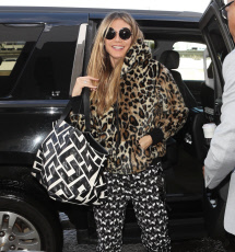 Heidi Klum roaring at LAX with leopard fur