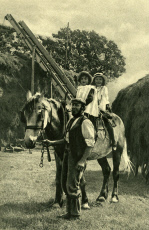 Farmer leading two children on a horse, England