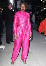 Lupita Nyong'o wears yellow contacts and sparkling pink jumpsuit while out in New York
