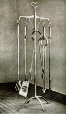Stand of fire irons in polished wrought iron