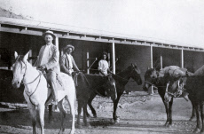 Mounted police constable and aborigine trackers on patrol