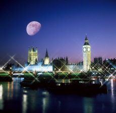 The Houses of Parliament, Westminster at night with Moon