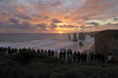 Silhouette of Tourists looking at the Twelve Apostles Great Ocean Road in Victoria Australia
