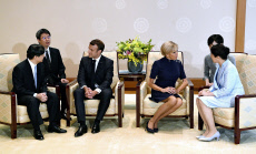 President Macron meets Japan's Imperial couple in Tokyo