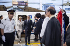 Emmanuel Macron and his wife pictured upon their arrival at Kyoto