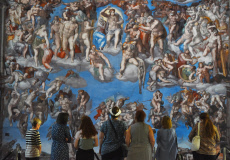 A group admire the spectacular, 'Last Judgement' canvas replica by Michelangelo at the 13th century Great Hall in Winchester