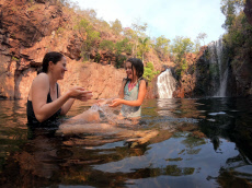 Mother and daughter having fun in Florence Falls  Northern Territory Australia