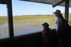 Mother and daughter looking a the landscape view of Wetland swamp Kakadu National Park Northern Territory Australia