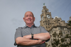 LIVER-ING ON THE EDGE! DAREDEVIL OAP DUBBED ORIGINAL THRILL SEEKER REVEALS AMAZING PIC OF HIM RIDING LIVERPOOL'S ICONIC 185FT LIVER BIRDS - WITHOUT HARNESS