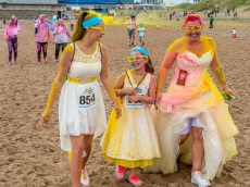 WEDDING REHASHER! MUM SO DESPERATE TO REWEAR HER WEDDING DRESS SHE COMPLETED A 3K COLOUR RUN IN IT