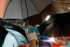 Hong Kong: Anti-Mask Law Protests Continue in Thunderstorms