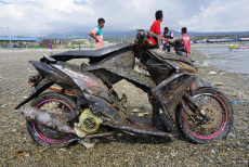 Indonesia: Motorcycle Dragged by the Impact of Tsunami Disaster in Palu, Found on the Seabed
