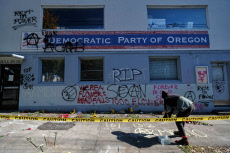 OR: Spray Painted Messages Left At Memorial For Activist Sean Kealiher