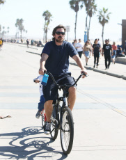 PREMIUM EXCLUSIVE Christian Bale enjoys bike ride with son in Venice