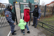 Russia: Russian National Guard officers check kindergarten security guards