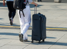 Tourist with rolling suitcase