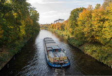Inland cargo ship on the Teltow Canal Berlin