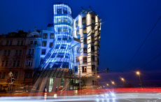 The Dancing House lit in the turquoise colour of the UNICEF