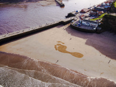 Giant Carbon Footprints, Whitby Bay Beach, England