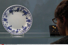 A second-class china plate and gold cuff links found in the Titanic wreckage are among a sampling of Titanic artifacts on preview Thursday, Jan. 5, 2012 in New York. The complete collection of artifacts recovered from the wreck site of the RMS Titanic wil