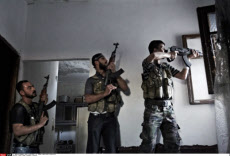 SYRIA: REBEL FIGHTERS IN ALEPPO