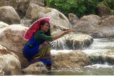 Thailand, Ayudhaya, Woman at Waterfall