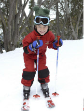 Australia, Victoria, Mt. Buller, Boy skiing in Snow