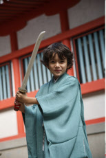 Japan, Tokyo, Young Boy in Kimono holding Sword