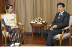 YANGON, Myanmar - Japanese Prime Minister Shinzo Abe (R) and Myanmar opposition leader Aung San Suu Kyi hold talks in Yangon, Myanmar, on May 25, 2013. (Pool photo by Kyodo News)(Kyodo) Photo via Newscom