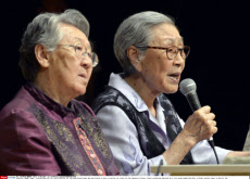 OSAKA, Japan - Kim Bok Dong (2nd from L), 87, and Kil Won Ok (2nd from R), 84, two South Korean women who were forced to serve as wartime sex slaves for the Japanese military, attend a gathering organized by a civic group supporting them, in Osaka, wester