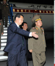 PYONGYANG, North Korea - Choe Ryong Hae (R), director of the General Political Bureau of the Korean People's Army of North Korea, arrives at Pyongyang airport on May 24, 2013, after visiting China as a special envoy of North Korean leader Kim Jong Un. (Ky