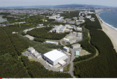 TOKAIMURA, Japan - Photo taken from a Kyodo News helicopter on May 25, 2013, shows a nuclear physics laboratory (front) of the Japan Atomic Energy Agency in Tokaimura, Ibaraki Prefecture, where radioactive substances were released into the atmosphere outs